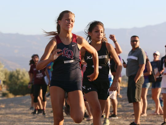 Varsity runners race to the finish during the first DVL cross country meet held at Xavier Prep High School in Palm Desert on Wednesday, September 20, 2017.