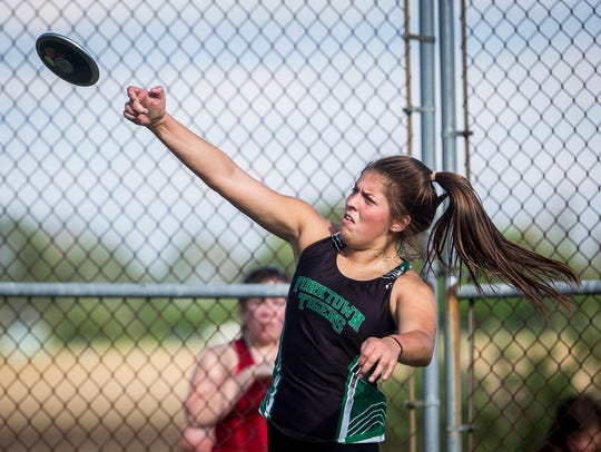 Yorktown's Ellie Miller throws the discus in the girls