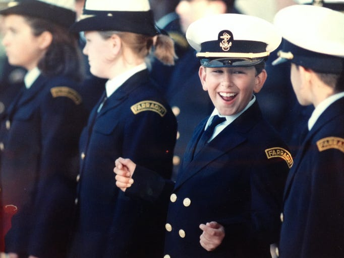 Eighth grade cadet Michael Oldewurtel shares a joke with a classmate before the start of Admiral Farragut Academy's last commencement ceremony on June 4, 1994.