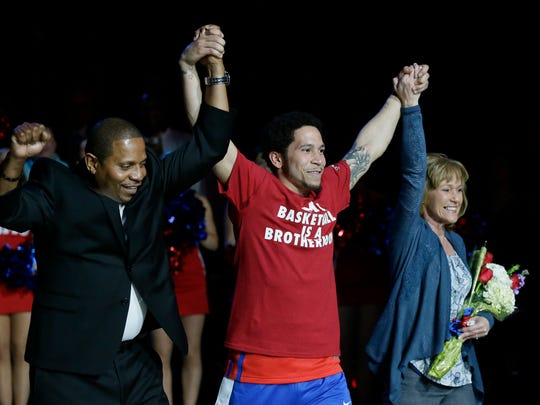 SMU guard Nic Moore, center, is introduced with his parents Michael Moore, left, and Karla Redden before an NCAA college basketball game against UConn Thursday, March 3, 2016, in Dallas.