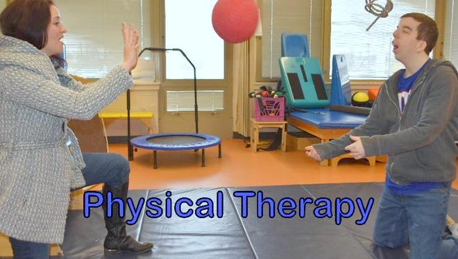 A Piscataway Regional Day School student participates with a physical therapist in the physical therapy room.