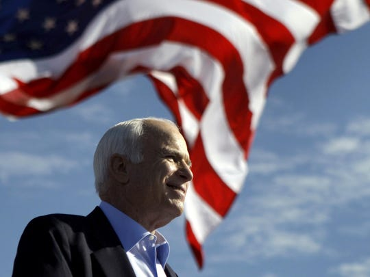 In this Nov. 3, 2008 file photo, Republican presidential candidate Sen. John McCain, R-Ariz. speaks at a rally outside Raymond James Stadium in Tampa, Fla.