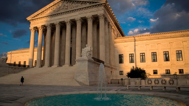 In this Oct. 10, 2017 photo, the Supreme Court in Washington is seen at sunset.  The Supreme Court is being asked to take a case about whether eye drops are too big. Don't roll your eyes. Major players in American's medicine cabinets are now asking the high court to take the case. On the other side are patients using the companies' drops to treat glaucoma and other conditions. They say wasted medication affects their wallets. They argue they should be able to sue. Drug companies, however, say the patients' argument is based on speculation and a bottle that doesn't exist.
