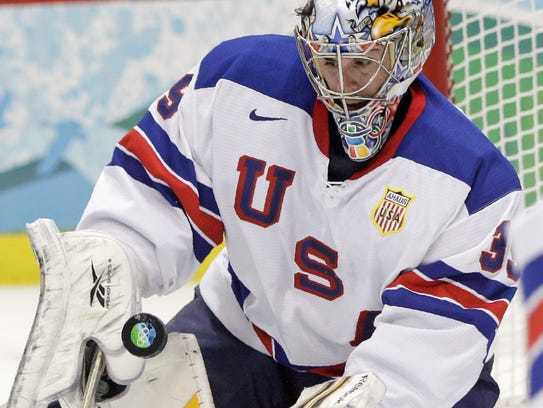 USA goalie Ryan Miller (39) makes a save in the second