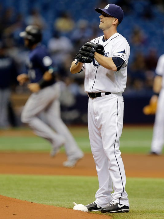 Tampa Bay Rays starting pitcher Drew Smyly reacts as Seattle Mariners' Nelson Cruz runs around the bases after his two-run home run during the fourth inning of a baseball game Wednesday, June 15, 2016, in St. Petersburg, Fla. (AP Photo/Chris O'Meara)