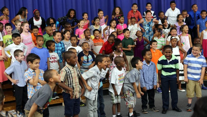 Students from Yonker's Cross Hill Academy school perform in their spring concert June 12, 2015.