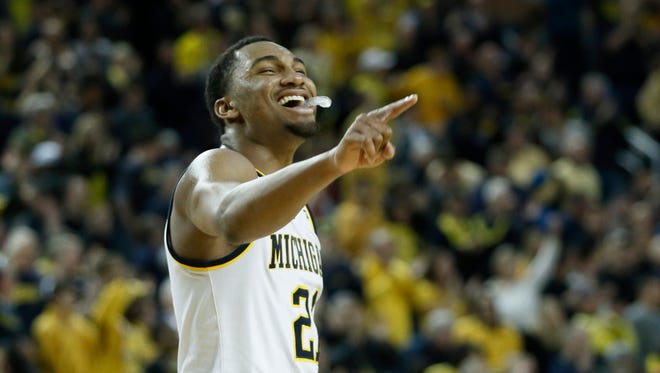 Zak Irvin celebrates after Michigan took the lead over Purdue late in the second half at Crisler Arena on Feb. 13, 2016, in Ann Arbor. Irvin scored 22 points in a 61-56 win over Purdue.