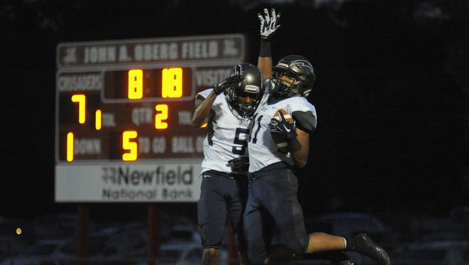 Timber Creek's Dante Waugh-Hill, 5, and Ezrah Archie, 11, celebrate a touchdown scored in the second quarter against Delsea on Friday.