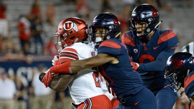 Sep 22, 2017: Arizona Wildcats safety Scottie Young Jr. (19) tackles Utah Utes running back Zack Moss (2) during the first half at Arizona Stadium.