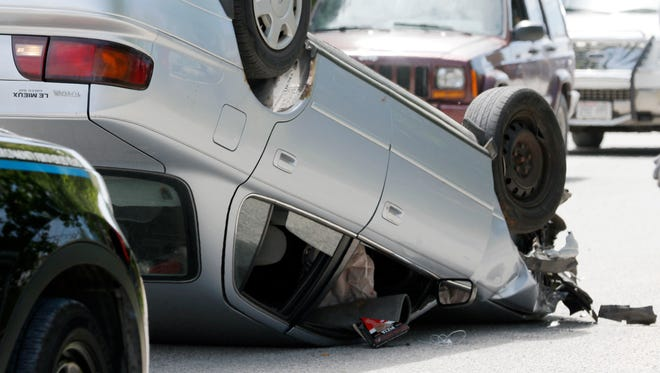 A one-vehicle rollover accident happened outside Eck Industries, Inc.'s gate on North Eighth Street on Wednesday afternoon, June 22. The driver of the silver Toyota Camry suffered minor injuries from the accident, according to police.