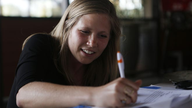 Rachel Musch-Taylor, a first-grade teacher at Lookout Mountain Elementary School, turns in signatures she gathered from other teachers while off-campus.