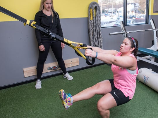 Kelly Mahoney of Evolve Training prompts Whitney Breckenridge, Fair Haven, through her workout at Evolve Training in Tinton Falls.