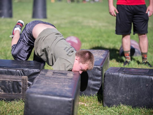 Marshall 6th grader Jacob Fitzpatrick does agility drills at youth football camp in Marshall.