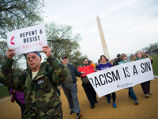 Marchers in Washington, D.C., walk along the National