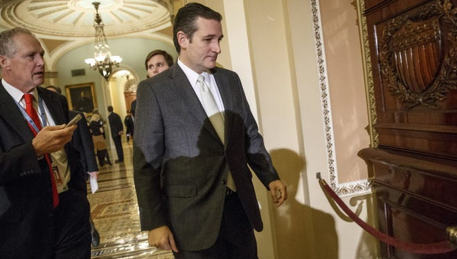 In this Dec. 16, 2014 file photo, Sen. Ted Cruz, R-Texas arrives at the Senate on Capitol Hill in Washington. Florida Sen. Marco Rubio seems to be moving toward a bid for the Republicans' presidential nomination, and late Sunday he joins Sens. Ted Cruz of Texas and Rand Paul of Kentucky for an audience with the conservative billionaire Koch brothers.