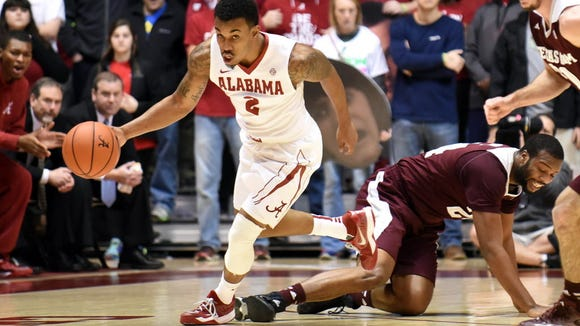 Jan 6, 2015; Tuscaloosa, AL, USA; Alabama Crimson Tide guard Ricky Tarrant (2) takes possession of the ball from Texas A&M Aggies forward Antwan Space (24) during the first half at Coleman Coliseum. Mandatory Credit: Kelly Lambert-USA TODAY Sports
