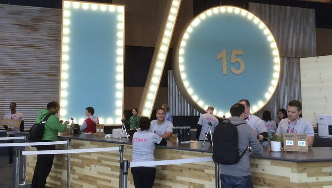 Google launched its Photos app at Google I/O in May. Here staffers wait to check in conference attendees at the Moscone Center in San Francisco.