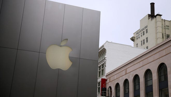 The Apple logo is displayed on the exterior of an Apple Store on July 21, 2015 in San Francisco, California.