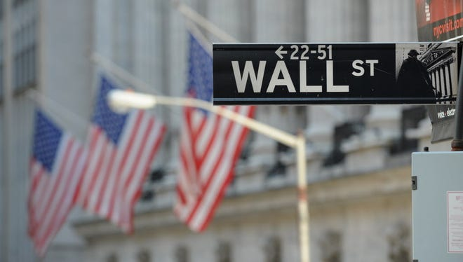 This file photo taken on February 28, 2012 shows the Wall Street sign outside the New York Stock Exchange in New York.