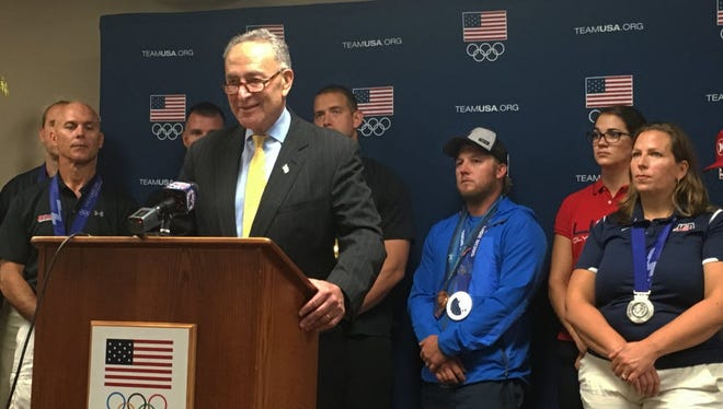 U.S. Sen. Charles Schumer, D-N.Y., speaks Aug. 2 at the Olympic Training Center in Lake Placid, New York, urging the U.S. House of Representatives to pass legislation that would exempt American medalists from having to pay taxes on medals won and income earned at Olympic contests.