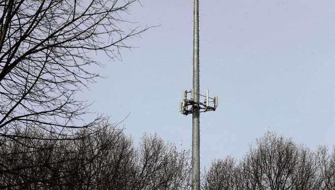 In this March 13, 2017 photo, a cell tower is seen through trees in North Andover, Mass. Insurance companies are using cellphone tower data to deny claims for stolen cars, burned homes and other mishaps, despite the information coming under question at criminal trials across the country.