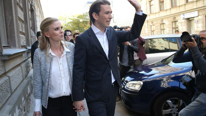 Austrian Foreign Minister and leader of the conservative Austrian Peoples Party and his girlfriend Susanne Thier leave a polling station after casting their ballots in Austrian parliamentary elections on October 15, 2017 in Vienna, Austria.