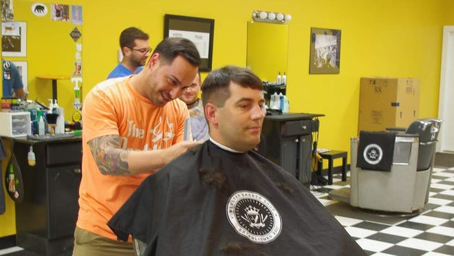 AJ Palagonia works on a client at the Webster Barber Shop
