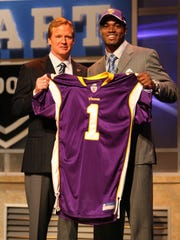 Commissioner Roger Goodell welcomed Adrian Peterson into the league at the NFL draft in 2007.