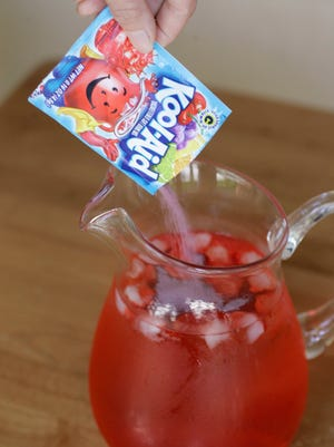 Sharon Robinson makes Tropical Punch Kook-Aid, which is made by Kraft Foods, in Palo Alto, Calif., on July 28, 2008.