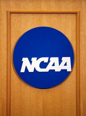 A close up of the NCAA logo on the podium as the NCAA holds a press conference