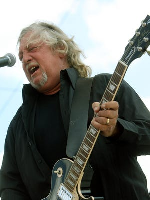 After his hat nearly blew off, John Anderson performs without it at the CMA Music Festival in Nashville in 2007.