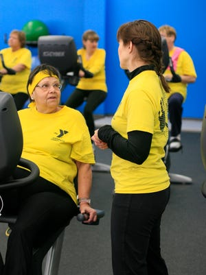 A free program at the YMCA offers wellness support to cancer survivors in the community. Pictured, program participants Martha and Barbara Mooney talk during a Livestrong at the YMCA session.