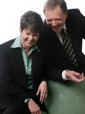 Demetria Kalodimos and Dan Miller crack up during a Channel 4 publicity photo shoot.