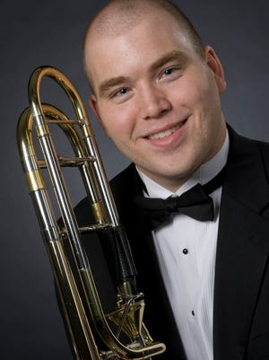 Jeremiah Eis is the conductor of the N.E.W. Wind Symphony.