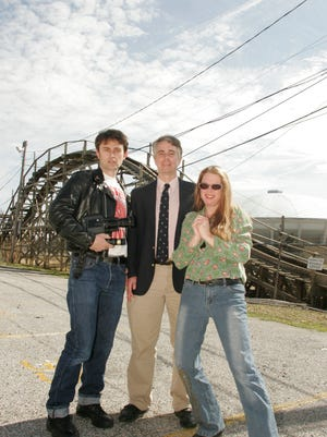 Working to save Libertyland, a decade ago: Mike McCarthy (left), Steve Mulroy, Denise Parkinson and the Pippin (background).
