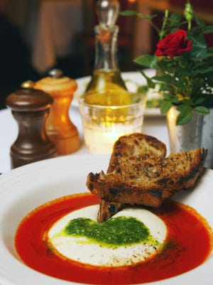 Warm, hand-pulled mozzarella ladled w basil pesto and served in a puddle of late-season tomato broth from Rancho Pinot.
