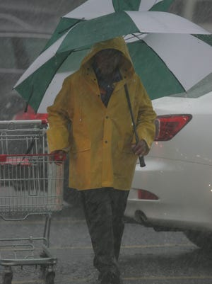 A man shopping in the pouring rain last year