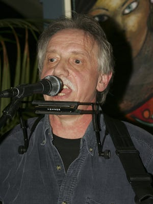 Singer/songwriter George Wirth, pictured performing in 2011.