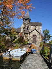 Tom Klein ties up a boat at the St. Hubert's Chapel