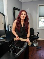 Michelle Cleveland owns Hair Addict Salon & Extension