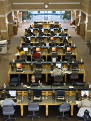 Students fill many of the computer pods at ASU West's