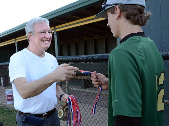 Steve Shelander gives a medal to Howell's Brandon Leon after the Highlanders won Saturday's championship game in the Lee Shelander Classic. Steve Shelander and Lee's widow, Mary, had lost track of the tournament over the years and were pleased to hear it was still being held. Saturday's edition was the 41st, with just two rainouts. Steve and Mary were part of the crowd at Saturday's final.