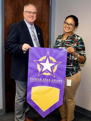 Eight Onslow County schools recently received banners after being awarded the Purple Star Designation by the North Carolina Department of Public Instruction. This designation recognizes schools that demonstrate military-friendly practices and a commitment to military students and families: Carolina Forest International Elementary, Dixon Elementary, Jacksonville Commons Elementary, Meadow View Elementary, Northwoods Elementary, Richlands High, Sand Ridge Elementary and Southwest Elementary.