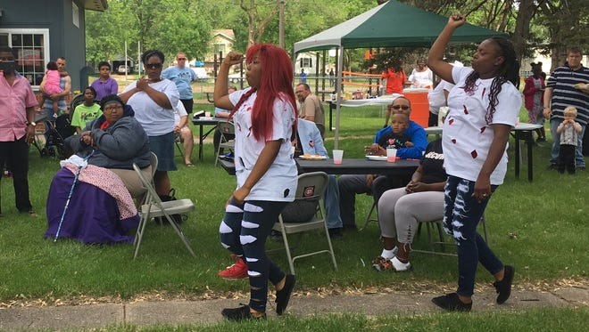 Women from a dance group at Higher Ground Church performed at Race Unity Day at Promise Neighborhood of Central Minnesota on Sunday, June 10.