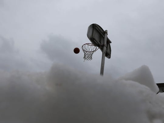 Even with snow surrounding the court, Rafat Saada 15 of Clifton came out in the cold to shoot baskets on the asphalt court at Clifton Elementary School 1.