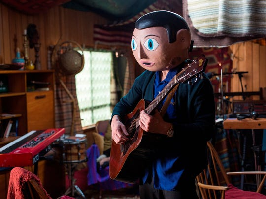 "Michael Fassbender plays an indie rocker in ""Frank."""