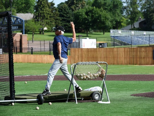 """Local baseball legend Lee """"Goldy"""" Goldammer pitches"""