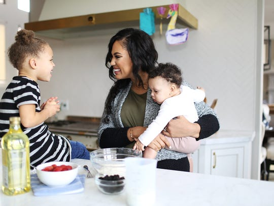 Curry often involves her daughters, Riley, left, and