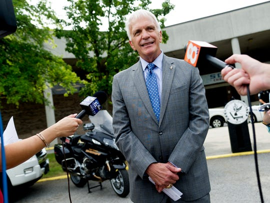 Superintendent Bob Thomas speaks with the media during