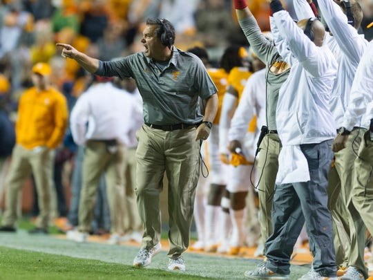 Tennessee Interim Head Coach Brady Hoke calls from the sidelines during a game between Tennessee and LSU at Neyland Stadium in Knoxville, Tennessee, on Saturday, Nov. 18, 2017.